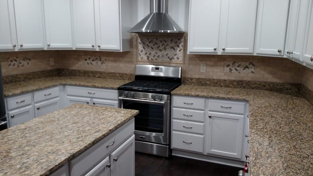 lotus interiors -- kitchen backsplash -- tile mosaic -- interior remodeling
